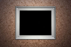 Vintage brown wall with picture frame Stock Image