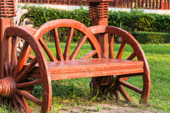 Vintage brown wooden bench in the garden Royalty Free Stock Photography