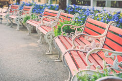 Vintage brown wooden bench in the garden Stock Photos
