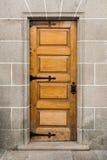Vintage brown wooden door Stock Images