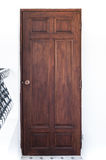 Vintage brown wooden door on white wall Royalty Free Stock Image