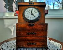 Vintage brown wooden table clock royalty free stock photo
