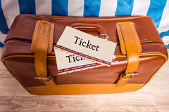 Vintage brown yellow leather bag suitcase with tickets. Travel m Stock Photography