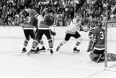 Vintage Bruins v. Blackhawks match up. Boston Bruins Wayne Cashman puts a shot on Blackhawks goalie Tony Esposito.. (Scanned from B&W negative royalty free stock photography