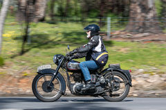 Vintage BSA Motorcycle on country road. Adelaide, Australia - September 25, 2016: Vintage BSA Motorcycle on country roads near the town of Birdwood, South Royalty Free Stock Photo