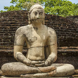 Vintage Buddha statue in meditation royalty free stock images