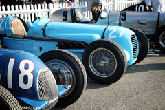 Vintage Bugatti Racing Cars. Classic racing cars waiting in the paddock to race Royalty Free Stock Images