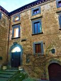 Vintage building and atmosphere, architecture, art and light in Civita di Bagnoregio, province of Viterbo, Italy. Building, windows, door, arch, architecture stock image