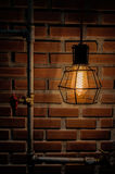 Vintage bulb Lighting Decor home interior with blick wall backgrbrick  Royalty Free Stock Photos