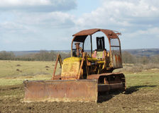Vintage bulldozer. Standing in a field Stock Image