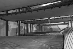 Vintage bunk beds in WWII Liberty Ship troop transport in black. Rows of beds inside WWII Liberty Ship troop transporter in black and white Stock Photo