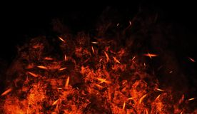 Vintage burn flames with particles embers on isolated black background. Fire texture effect background stock image