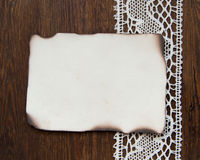 Vintage burned paper card and crochet lace Stock Photo