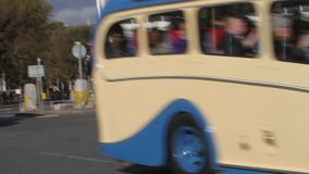 Vintage bus driving in Brighton stock video footage