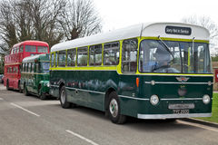 Vintage buses and coaches. WANSFORD, ENGLAND - APRIL 3: Three preserved vintage buses line up outside Wansford railway station to give short trips to the public Stock Photo