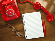 Vintage business concept. Retro telephone, notebook, pen and gla Royalty Free Stock Image