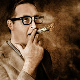 Vintage business man smoking money in success Royalty Free Stock Photo