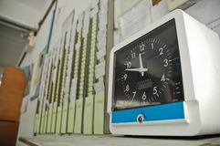 Vintage business payroll clocking system. Vintage classical clocking system for payroll to let employee sign up and and sign off after working day in day out stock image