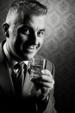 Vintage businessman holding a glass of whisky Royalty Free Stock Photos