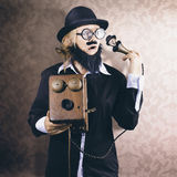 Vintage Businessman listening to conscience Royalty Free Stock Images