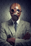 Vintage businessman wearing gas mask Stock Image