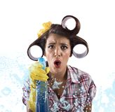 Vintage busy housewife. Housewife cleans with soap and detergent spray Royalty Free Stock Photo