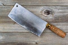 Vintage butcher Knife on aged wood Stock Images