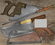 Vintage butcher shop set over wooden table Stock Photos