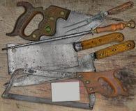 Vintage butcher shop set over wooden table Royalty Free Stock Images