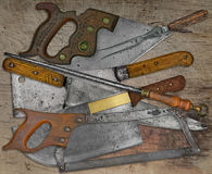 Vintage butcher shop utensils over wooden table Royalty Free Stock Photography