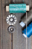 Vintage buttons flowers and spools with threads Stock Images