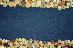Vintage Buttons frame on a denim fabric texture background Stock Photography
