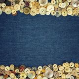 Vintage Buttons frame on a denim fabric texture background Royalty Free Stock Photos