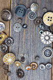 Vintage buttons on old wooden boards Stock Images