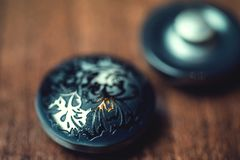 Vintage buttons with ornament on wooden background Stock Photo