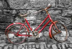 Old bycicle on a wall. Vintage bycicle standing on a wall Stock Images