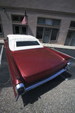 Vintage Cadilac and US Flag parked in front of Saddle Shop, Oak View, California, USA Royalty Free Stock Photography
