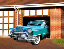 Vintage cadillac in garage. Photo of a vintage blue cadillac which has been stored in garage and going for a cruise Stock Photos