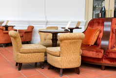 Vintage cafe with easy armchairs and sofas Royalty Free Stock Image