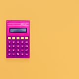 Vintage calculator on bright yellow background Stock Photo
