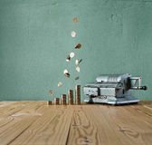 Vintage calculator and money rain Royalty Free Stock Photo
