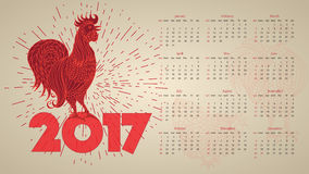 2017 Vintage calendar with red rooster. Hand-drawn doodle contour and silhouette. Vector illustration. Symbol New Year Chinese horoscope Stock Photography