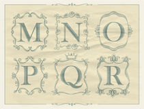 Vintage calligraphic letters in monogram retro frames, alphabet logos Royalty Free Stock Photo