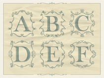 Vintage calligraphic letters in monogram retro frames, alphabet logos Royalty Free Stock Photo
