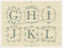 Vintage calligraphic letters in monogram retro frames, alphabet logos Stock Photography