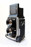Vintage Camera. A vintage 6x6 camera with a twin lens reflect, on white background Royalty Free Stock Photos
