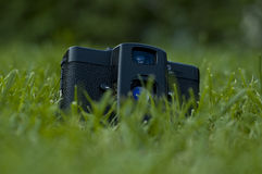 Vintage camera. In grass on nature background Royalty Free Stock Photo
