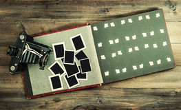 Vintage camera and album with old photo frames Royalty Free Stock Photo