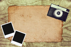 Vintage camera. Background with polaroids Royalty Free Stock Photography