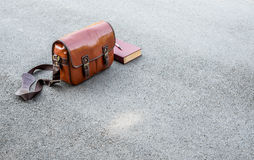 Vintage camera bag and book on street Stock Photography